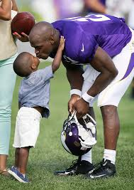 Adrian Peterson and son